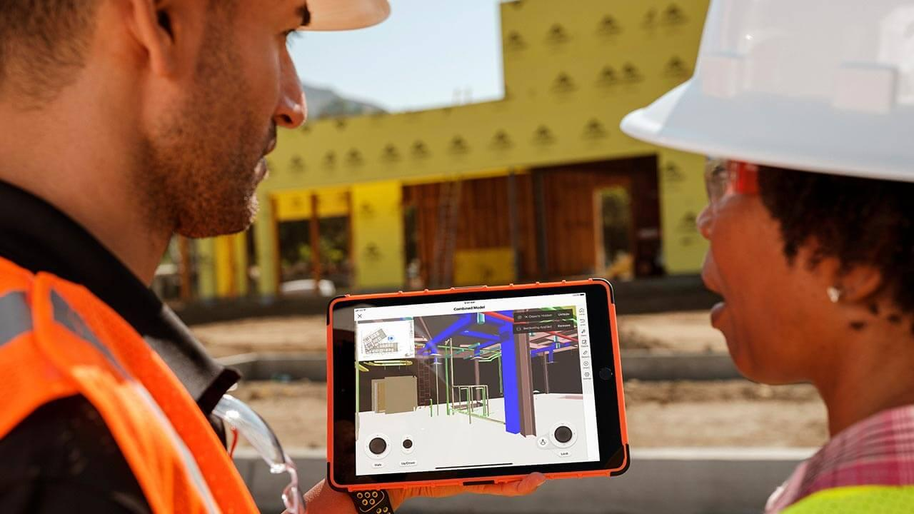 Construction workers uses Procore BIM on a jobsite