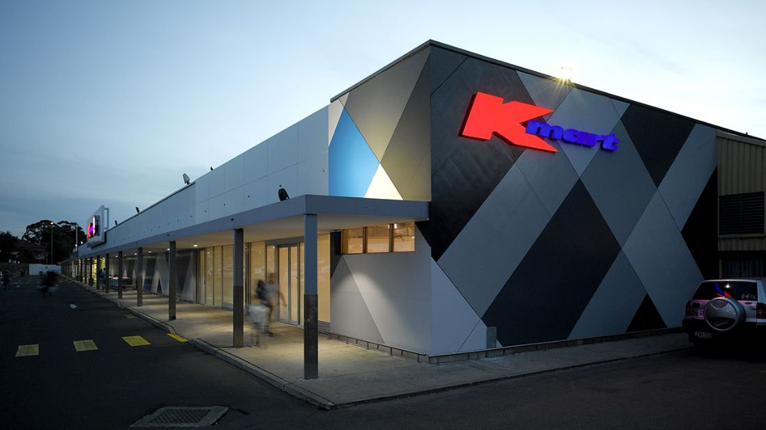 Horizontal view of a Kmart's entrance
