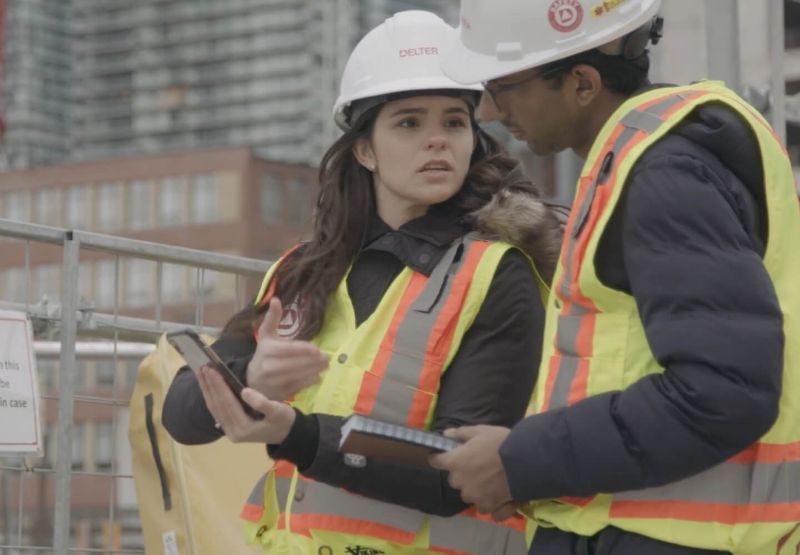 Construction workers communicating on a jobsite