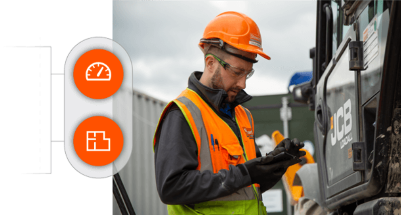 Construction worker checks Procore software on site