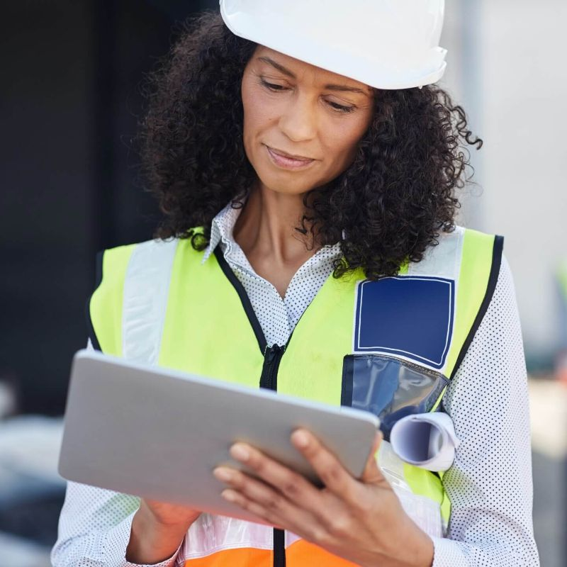 Construction worker looking at iPad