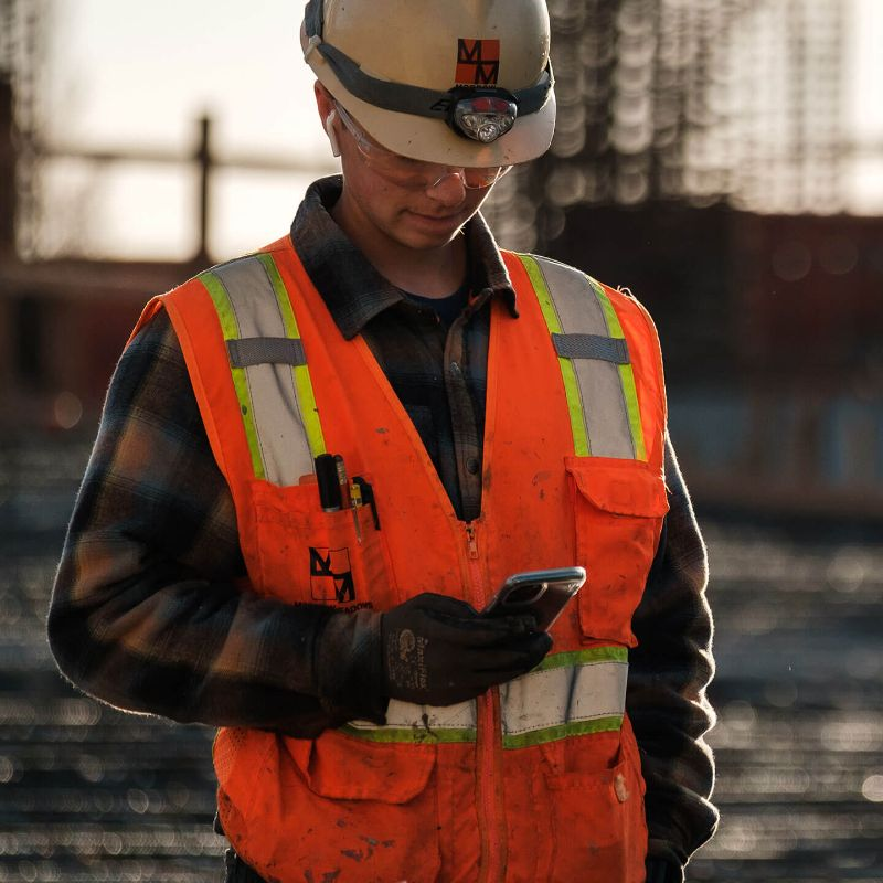 Construction worker on mobile device