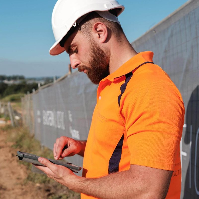 worker using Procore on a mobile device