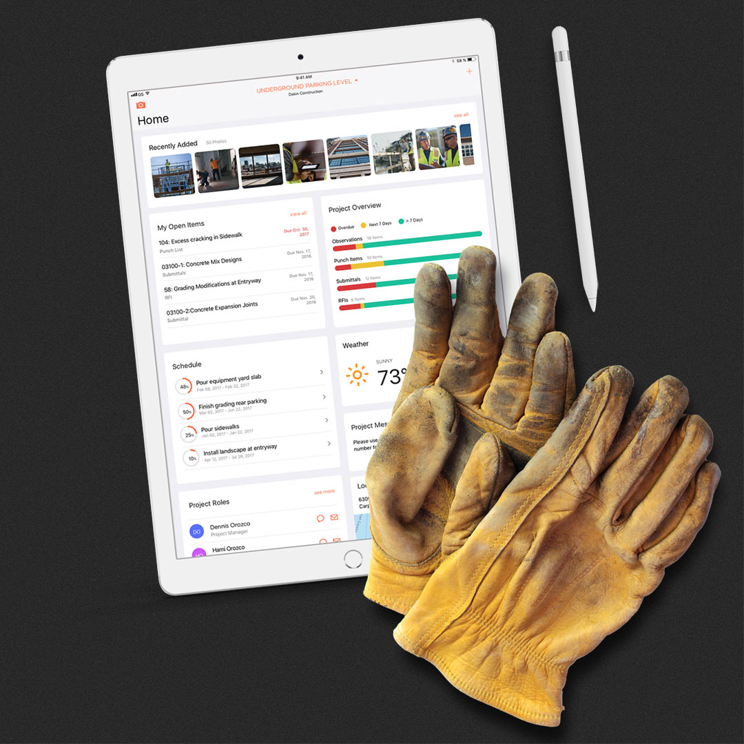Procore platform represented by tablet and gloves
