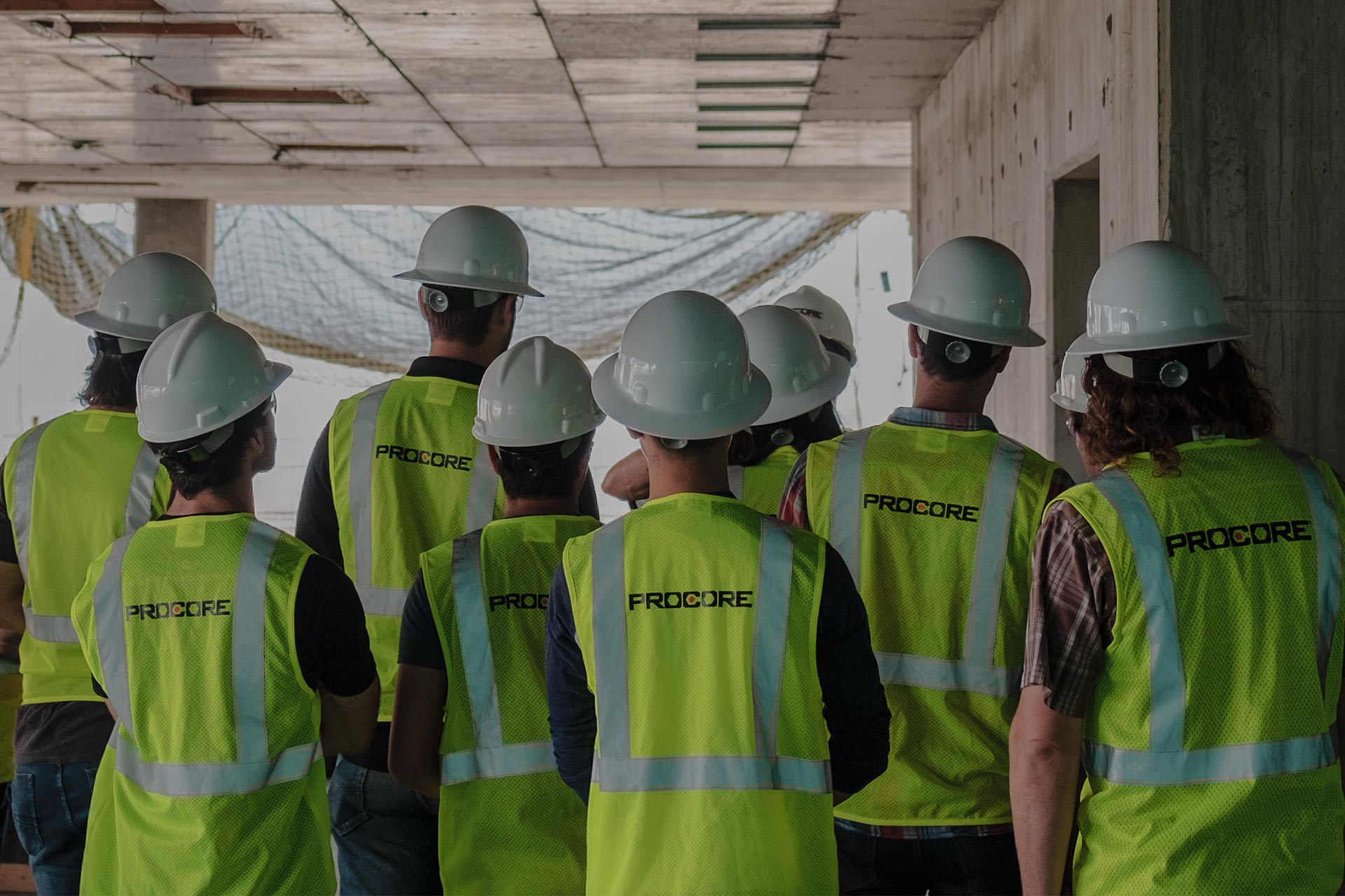 Construction workers with Procore safety vests